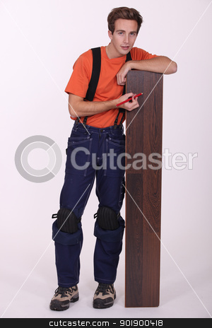 Young man with wood flooring stock photo, Young man with wood flooring by photography33