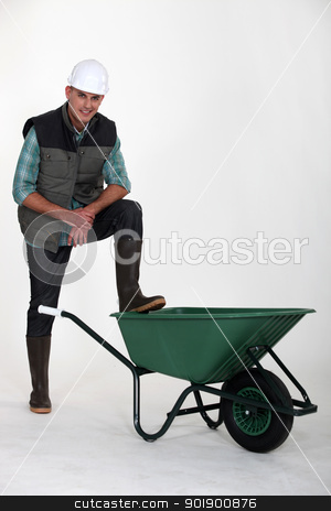 Construction worker with empty wheelbarrow stock photo, Construction worker with empty wheelbarrow by photography33
