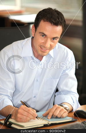 Man writing on diary stock photo, Man writing on diary by photography33