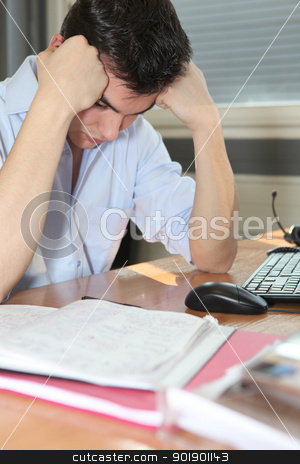Man depressed at his desk stock photo, Man depressed at his desk by photography33