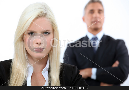Blonde woman and man in the background stock photo, Blonde woman and man in the background by photography33
