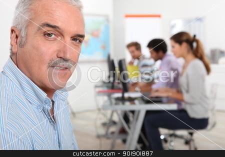 A teacher in his classroom stock photo, A teacher in his classroom by photography33