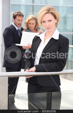 Serious executives outside office building stock photo, Serious executives outside office building by photography33