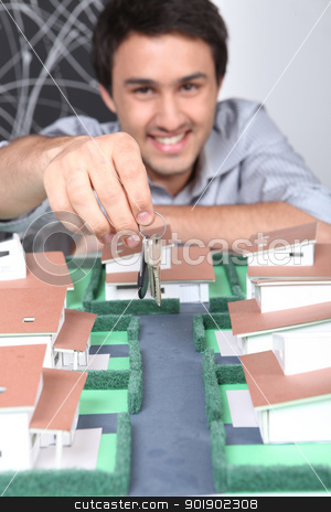 Young estate-agent dangling house keys stock photo, Young estate-agent dangling house keys by photography33