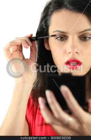 Woman applying mascara stock photo, Woman applying mascara by photography33
