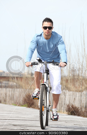 Young man riding a bicycle stock photo, Young man riding a bicycle by photography33