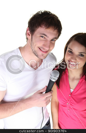 Couple sharing a microphone stock photo, Couple sharing a microphone by photography33
