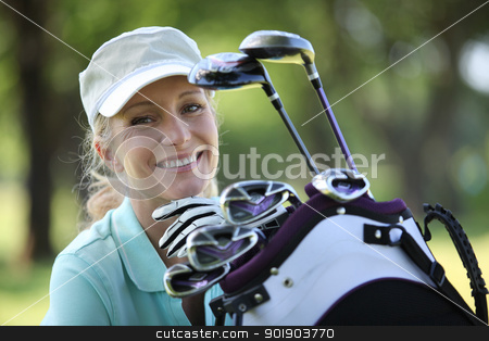 woman with a bag full of golf clubs stock photo, woman with a bag full of golf clubs by photography33