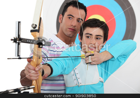 Teenage boy archery lesson stock photo, Teenage boy archery lesson by photography33