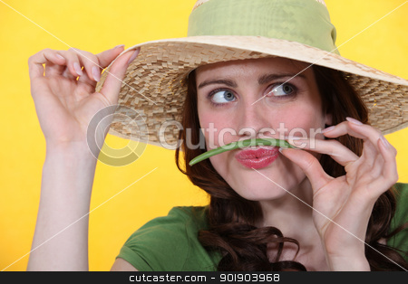 Woman using green bean as moustache stock photo, Woman using green bean as moustache by photography33
