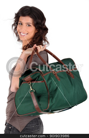 Woman carrying a weekend bag stock photo, Woman carrying a weekend bag by photography33