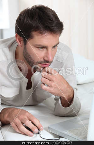 Man holding a computer mouse stock photo, Man holding a computer mouse by photography33