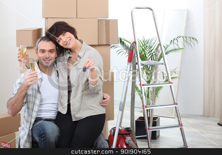 couple celebrating their new apartment stock photo, couple celebrating their new apartment by photography33