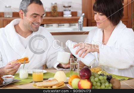 Couple having breakfast together stock photo, Couple having breakfast together by photography33