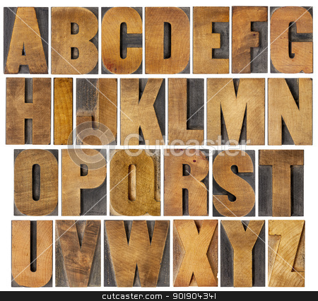 antique alphabet set in wood type stock photo, complete English alphabet - collage of 26 isolated vintage wood letterpress printing blocks, scratched and stained by ink patina, gothic bold extended font by Marek Uliasz