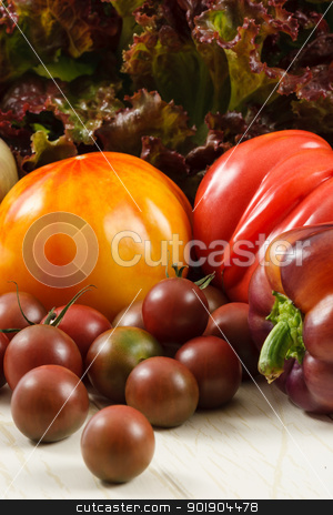 Fresh Tomatoes And Lettuce stock photo, Colorful fresh heirloom tomatoes with purple pepper and red leaf lettuce by Karen Sarraga