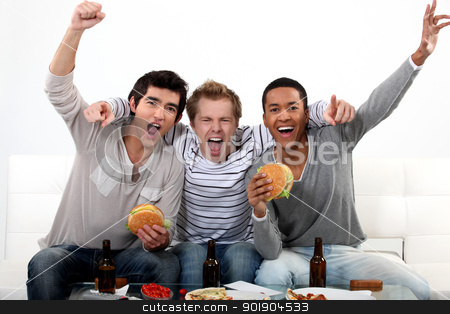Friends watching a football game together stock photo, Friends watching a football game together by photography33