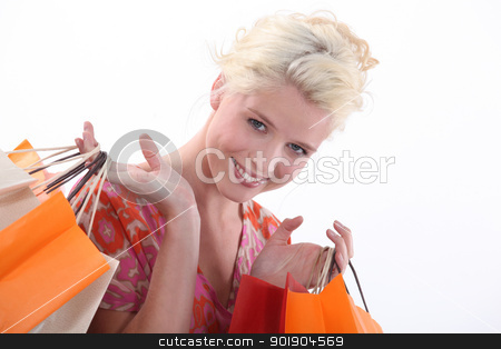 Woman holding shopping bags stock photo, Woman holding shopping bags by photography33