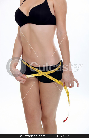 Woman with a tape measure stock photo, Woman with a tape measure by photography33