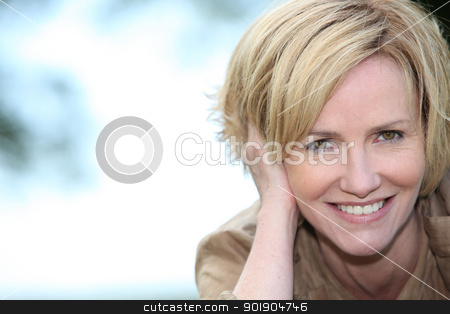 Portrait of a smiling woman stock photo, Portrait of a smiling woman by photography33