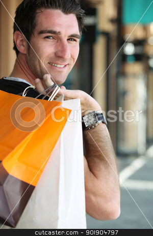 Man carrying shopping bags over shoulder stock photo, Man carrying shopping bags over shoulder by photography33