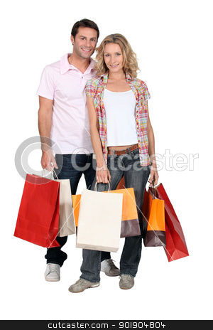 Couple with shopping bags stock photo, Couple with shopping bags by photography33