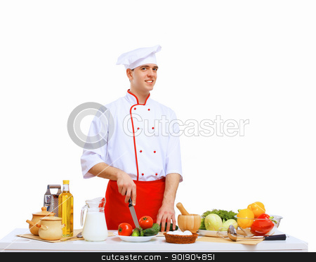 Young cook preparing food stock photo, Young cook preparing food wearing a red apron by Sergey Nivens