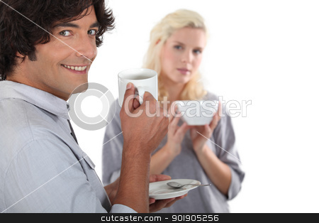 Couple drinking a hot drink stock photo, Couple drinking a hot drink by photography33