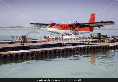 Seaplane stock photo, A sea plane moored at a dock awaiting passengers. by Abdul Sami Haqqani