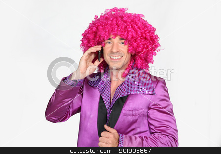 Man in a seventies disco costume and silly wig stock photo, Man in a seventies disco costume and silly wig by photography33
