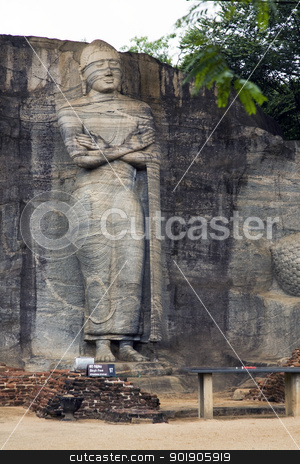 Standing Buddha at Polonnaruwa, Sri Lanka stock photo, The statues of the Lord Buddha in Gal Vihara at Polonnaruwa are cut from a single granite wall in 12th century A.D. The photograph here depicts the standing Buddha meditating and was commisioned by Parakramabahu. Polonnaruwa is a UNESCO World Heritage site. by Abdul Sami Haqqani