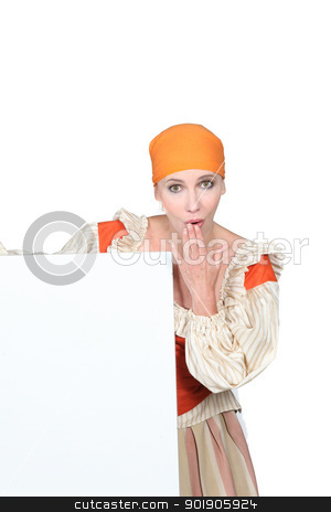 Woman dressed as a maid holding blank message board stock photo, Woman dressed as a maid holding blank message board by photography33