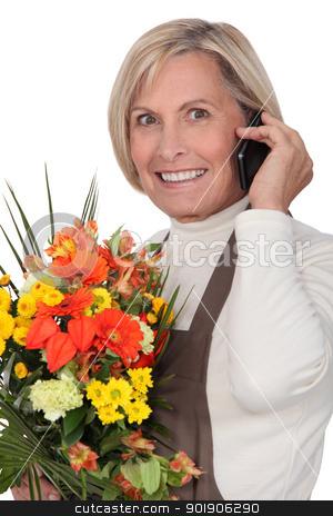 mature florist holding bouquet stock photo, mature florist holding bouquet by photography33