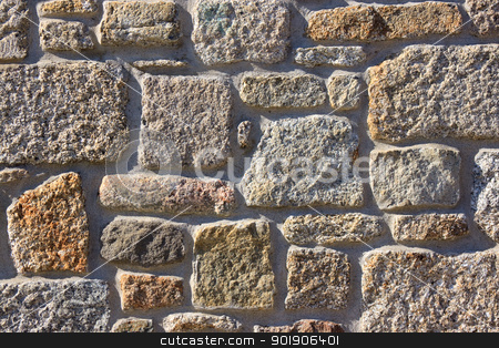 Stone Wall stock photo, Stone wall lit by sunlight from the side showing texture detail by Darren Pullman