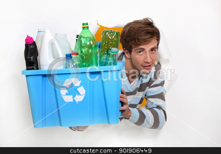 Man holding crate of bottles to be recycled stock photo, Man holding crate of bottles to be recycled by photography33