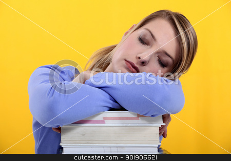 Student asleep on her books stock photo, Student asleep on her books by photography33