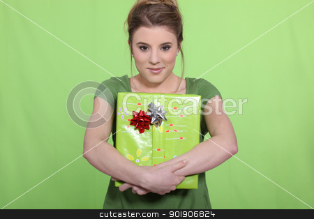 Woman in green with a green present stock photo, Woman in green with a green present by photography33