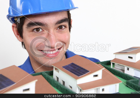 Young architect stood by model housing stock photo, Young architect stood by model housing by photography33