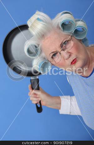 Angry old lady threatening to use frying pan stock photo, Angry old lady threatening to use frying pan by photography33