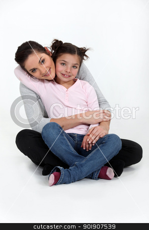 A mother and her daughter hugging. stock photo, A mother and her daughter hugging. by photography33