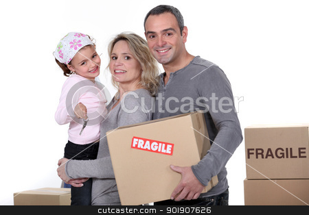 Young family moving house stock photo, Young family moving house by photography33