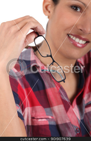 Young woman removing eyeglasses stock photo, Young woman removing eyeglasses by photography33