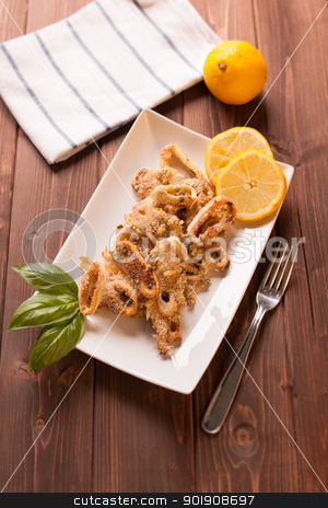 Squid rings gratin stock photo, Dish of squid rings gratin with lemon and basil by Giordano Aita