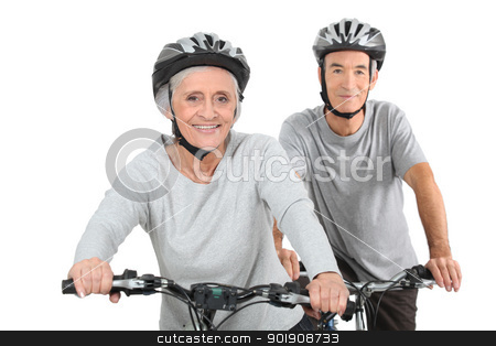 Elderly couple cycling stock photo, Elderly couple cycling by photography33