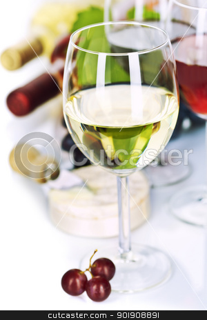 Wine stock photo, Grape and cheese with a bottles and glasses of red and white wine  by klenova