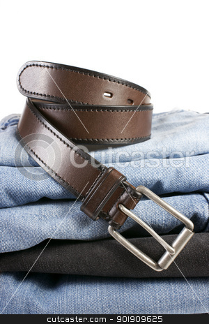 Stack of various shades of blue jeans with brown belts stock photo, Various shades of blue jeans with brown belts on a white background  by pixs4u