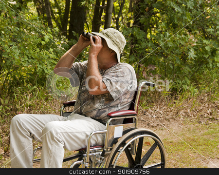 disabled bird watcher stock photo, disabled man in a wheelchair watching for birds with a pair of binoculars by digitalreflections