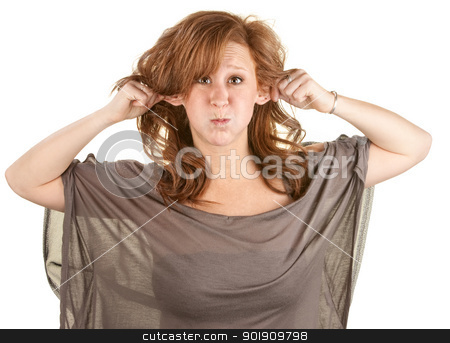 Young Woman Making Faces stock photo, Young woman pulling ears and puffing out her cheeks by Scott Griessel