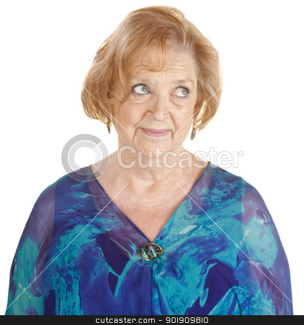 Skeptical Woman Looking Over stock photo, Doubting senior white female with eyes rolled up by Scott Griessel