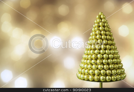 Christmas card stock photo, Christmas Tree of balls in foil against defocus lit background by Imaster